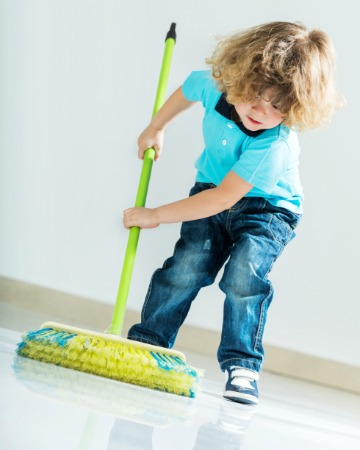 Beautiful little boy sweeping the floor.   [url=http://www.istockphoto.com/search/lightbox/9786682][img]http://dl.dropbox.com/u/40117171/children5.jpg[/img][/url]